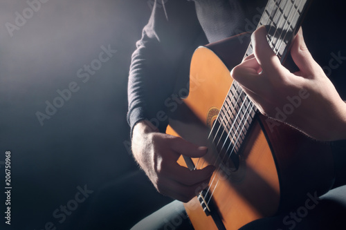 Fotoposter Muziek Acoustic guitar player. Classical guitarist hands