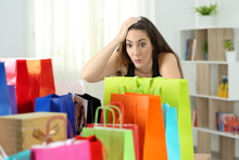 Surprised Woman Looking At Multiple Purchases