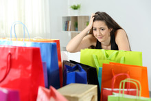 Worried Shopaholic Woman After...