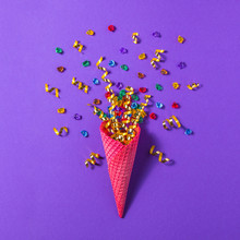 Ice Cream Cone With Golden Confetti And Gems On A Purple Background. Minimal Spring Concept. Flat Lay