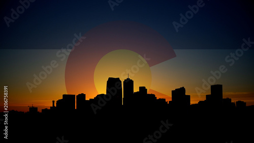 Valokuva  Denver Skyline Sunrise with Colorado Flag in Sky