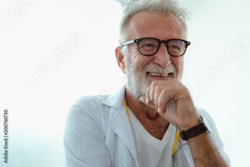 Portrait of senior laughing doctor