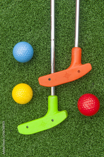 Colorful Putt Putt clubs and Balls