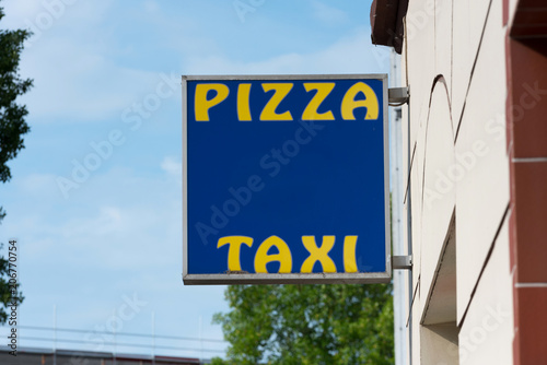 Keuken foto achterwand Pizzeria Ein Schild an einer Pizzeria