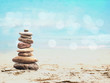 Pebble pyramid on summer beach