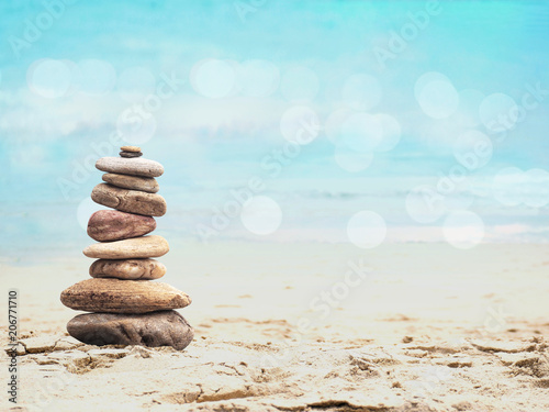 Aluminium Prints Stones in Sand Pebble pyramid on summer beach