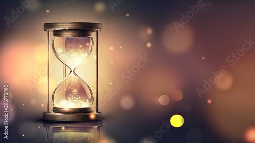 Obraz hourglass with shining light - fototapety do salonu
