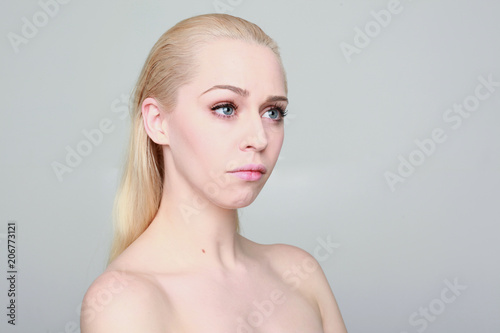 Valokuva  close up portrait of girl with blonde hair and pale skin, on studio background