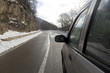 auto stops on mountain road rear-view mirror and snow