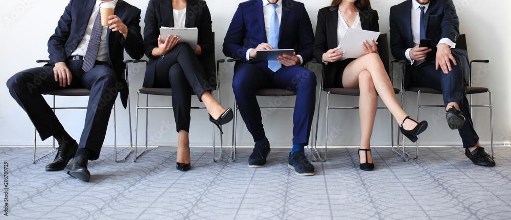 Fototapeta Stressful people waiting for job interview.