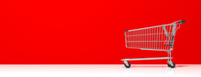 Shopping Trolley Empty, On Red Wall Background, Banner, Copy Space. 3d Illustration