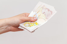 Ten Pound Notes Bundle In Female Hands