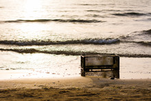 Fruit Crate As A Chair On The Beach