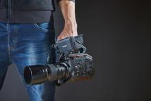 Kiev, Ukraine - April 22, 2018: Professional Video Man Hand Holding Video Camera Panasonic AU-EVA1 Operator Camcorder In Studio,