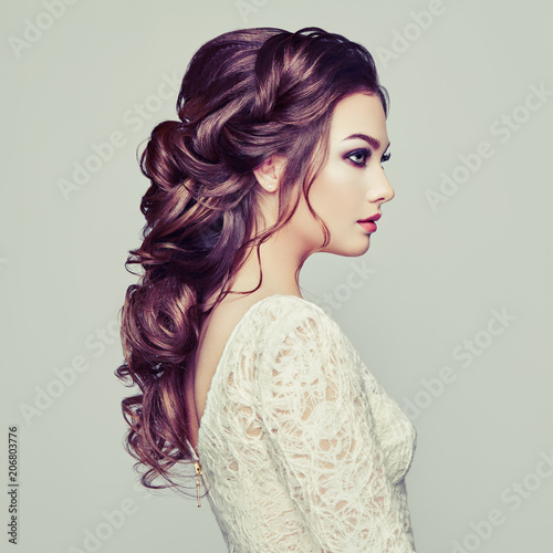 Fotografie, Obraz  Brunette woman with long and shiny curly hair