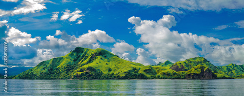 Panorama of a green hilly island near the island of Flores (Indonesia)