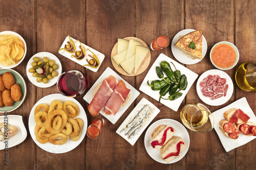 Spanish tapas food on dark background with wine and place for text