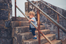 Little Boy Walking Up Some Stairs Outside