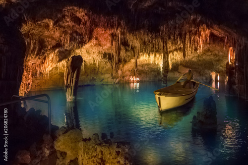 Natural formations Inside Drach cave of Mallorca with geological minerals and blue lake in Spain