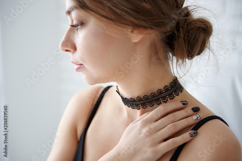 Young beautiful woman with a black choker on her neck Canvas Print