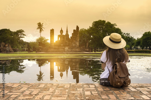 Tourist is traveling at Sukhothai Historical Park in Thailand. Wallpaper Mural
