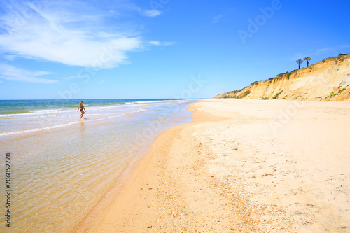 Young lady enjoys the sand beach south of Huelva, Atlantic coast, Andalusia, Costa de la Luz, Spain