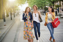 Cheerful Women Shopping Together In Town