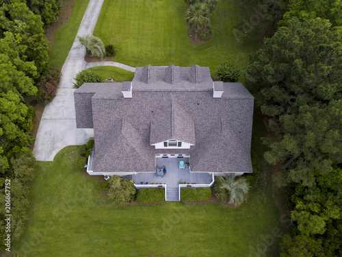 Fototapeta Aerial view of large home with new roof on beautiful property. obraz