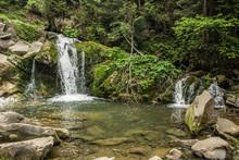 Small Waterfall In Mountain En...