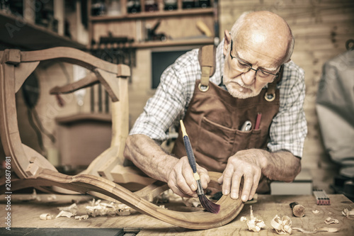 senior woodworker on duty Wallpaper Mural