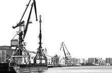 Two Old Port Crane Isolated On White Background. Construction Site. Contrasting Black-and-white Photograph