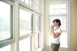 canvas print picture - Woman Looking Out the Window.