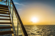 Stairway of cruise ship with beautiful sunset and ocean view.