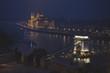 Tourist in a night scenary of the Danube river in Budapest