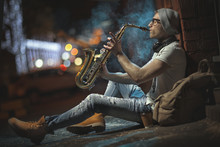 A Street Musician Plays The Sa...