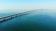 Aerial view of modern Oresund Bridge between Denmark and Sweden (Copenhagen and Malmo), clear blue sky, seascape of Baltic Sea with diagonal composition of very long sea bridge disappearing on horizon