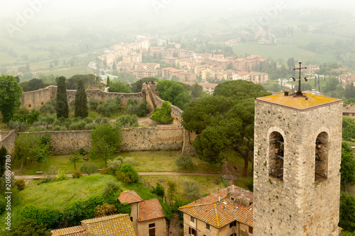 Poster Algérie Bell tower overlooking a nearby village in the medieval town of San Gimignano in Tuscany, Italy.