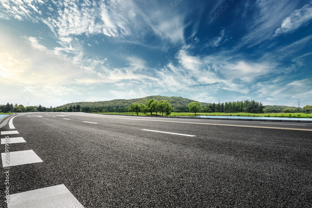 Fototapeta Asphalt road and mountain with sky clouds landscape at sunset