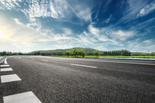 Asphalt Road And Mountain With...