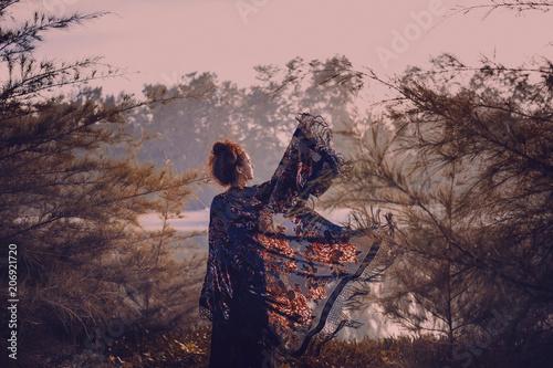 Foto auf AluDibond Rosa hell beautiful stylish woman silhouette wearing cape on sunset