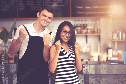Successful Small Business SME Owners Standing with Crossed Arms with Couple Partnership in Coffee Shop and Restaurant Background