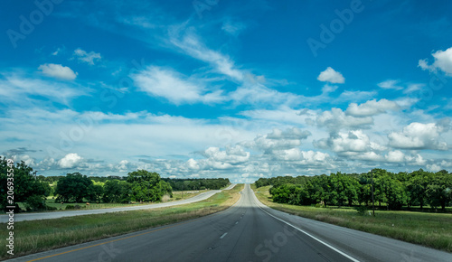 Poster Amérique du Sud Rural road in Texas, USA. Agricultural landscape and blue sky