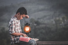 Boy Holding Oil Lamp And Reading Bible, Christian Concept