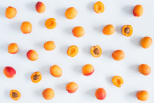 Apricots On Pastel Blue Backgr...