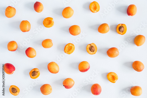 Apricots on pastel blue background. Flat lay, top view Fototapeta