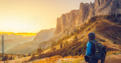 Spoed Foto op Canvas Oranje Traveler hiking breathtaking landscape of Dolomite