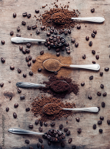 Fototapeta Different kinds of coffees on the spoons (coffee beans, ground coffee, instant coffee) obraz