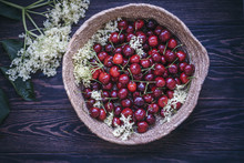 Fresh Cherries And Flowers In ...