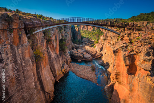 Poster Afrique du Sud A wide shot of the river gorge and a high bridge at Bourke's Luck Potholes in Mpumalanga, South Africa; a geological formation carved out by the movement of water