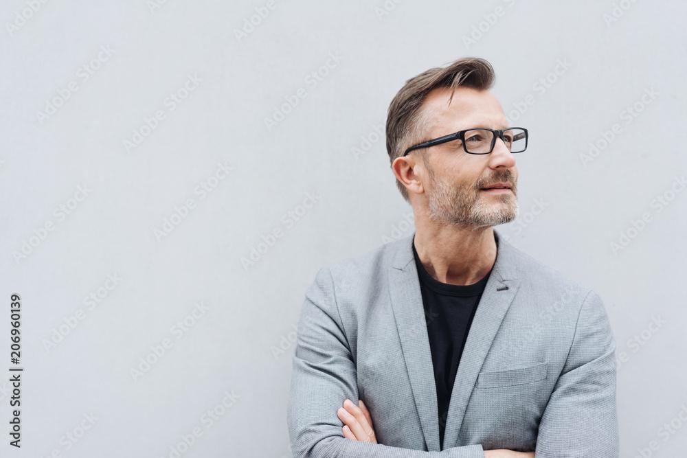 Valokuva  Mature man with glasses wearing grey jacket